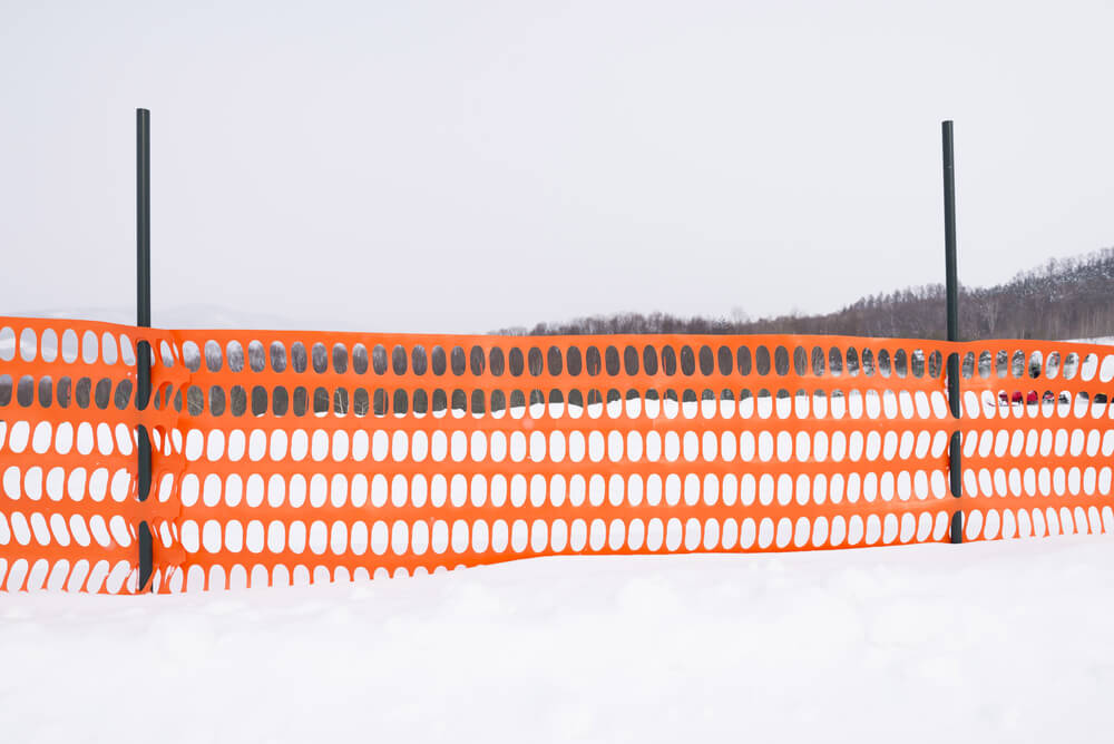 A simple orange plastic fence is a useful way to create a barrier for blocking snowdrift. Wood snow fences are also used but lack portability and tend to be more expensive.