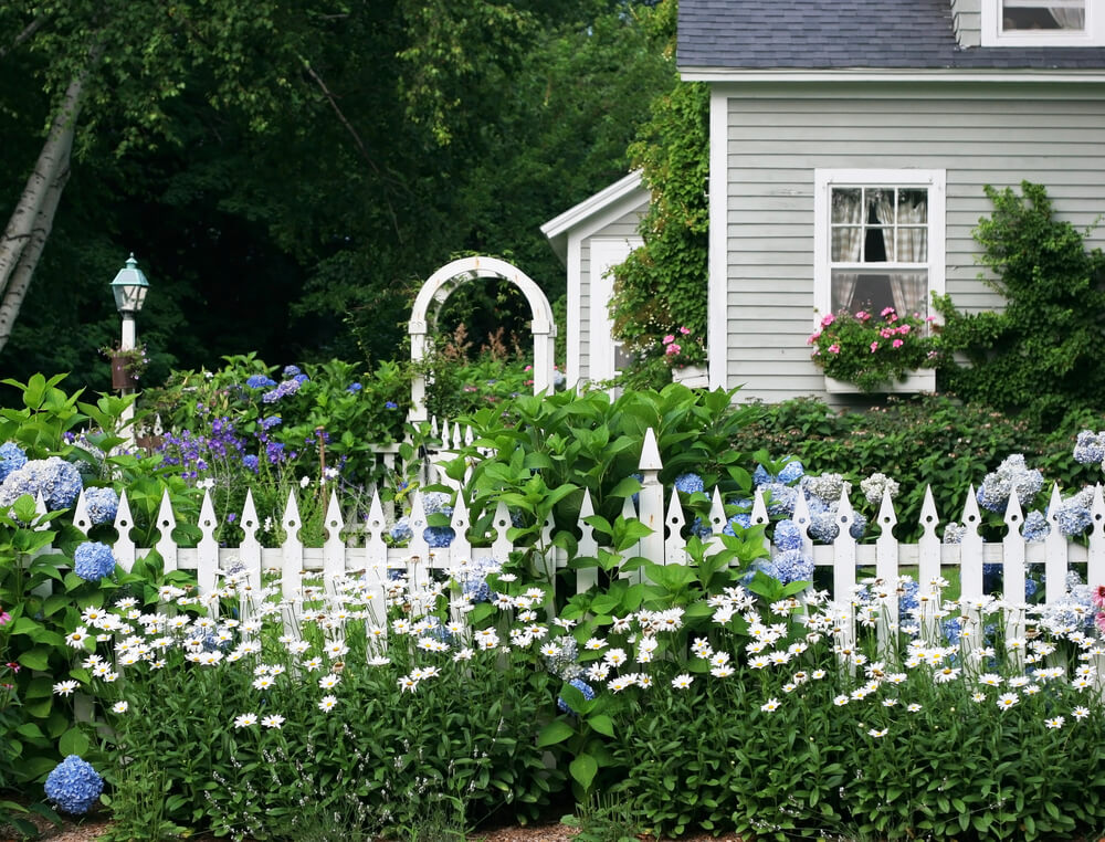 Classic english garden fencing makes a beautiful addition to any front or side yard.