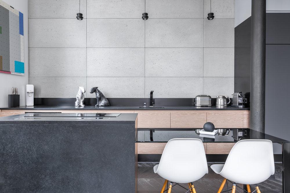 Ultra pale cupboards with no accents really make the absolute black granite pop and with the gray tiles on the back of this one you're getting something so modern it looks futuristic.
