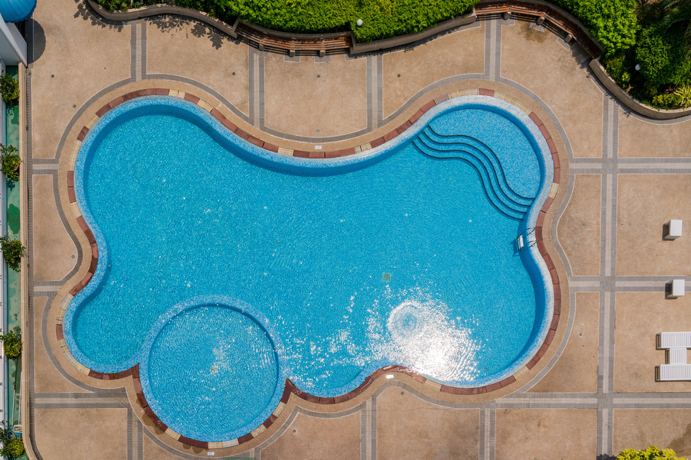 This pool has a super unique shape with all kinds of curves and a smaller circle off to the side. You're definitely going to be the only one with this setup for your pool and that's part of the fun.
