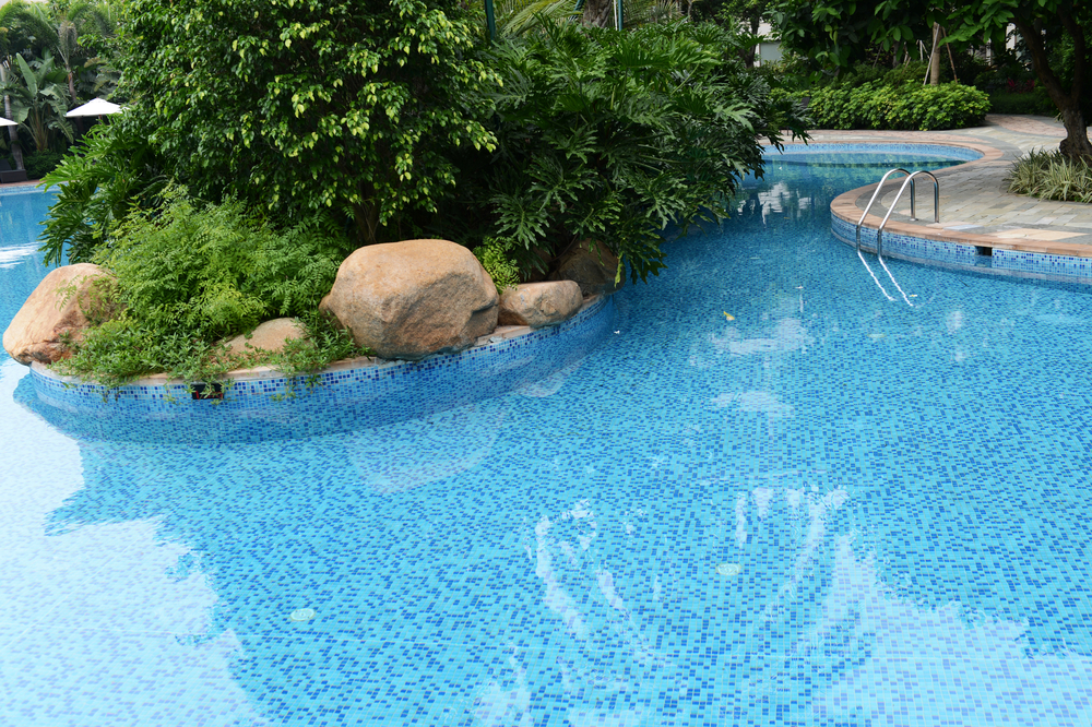 This landscaping gets you right up close and personal with the greenery because it's right in the middle of the pool. This takes a little more work to maintain, but the end result is like swimming in the jungle.