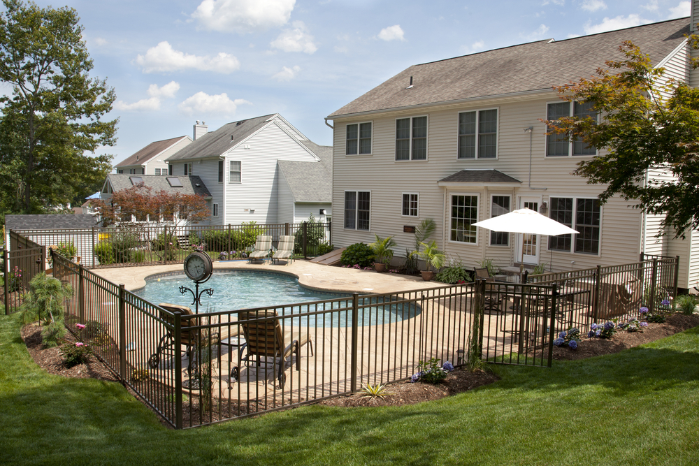 With this pool you have a stone deck and a fence around the outside that's going to give you a more private landscaping option.