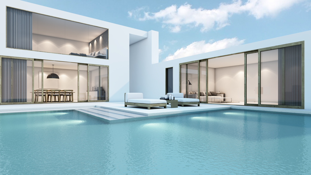 This building has everything you're looking for when it comes to modern and the pool is definitely an accent for that. It has sharp edges that really draw the eye and just the right seats sitting there on the side.