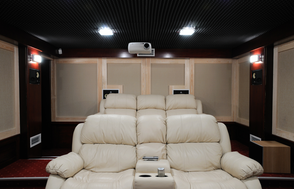 This room has really comfortable looking chairs on risers to make sure everyone can see. It's also got soundproofing on the sides and a good projector as well.