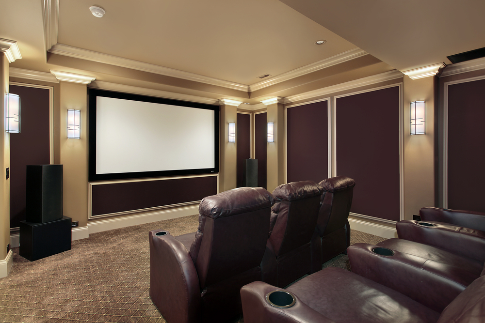 Here we've got individual chairs with cupholders again and huge speakers to take care of everything. You also get traditional movie theater lighting, which is definitely fun as well.