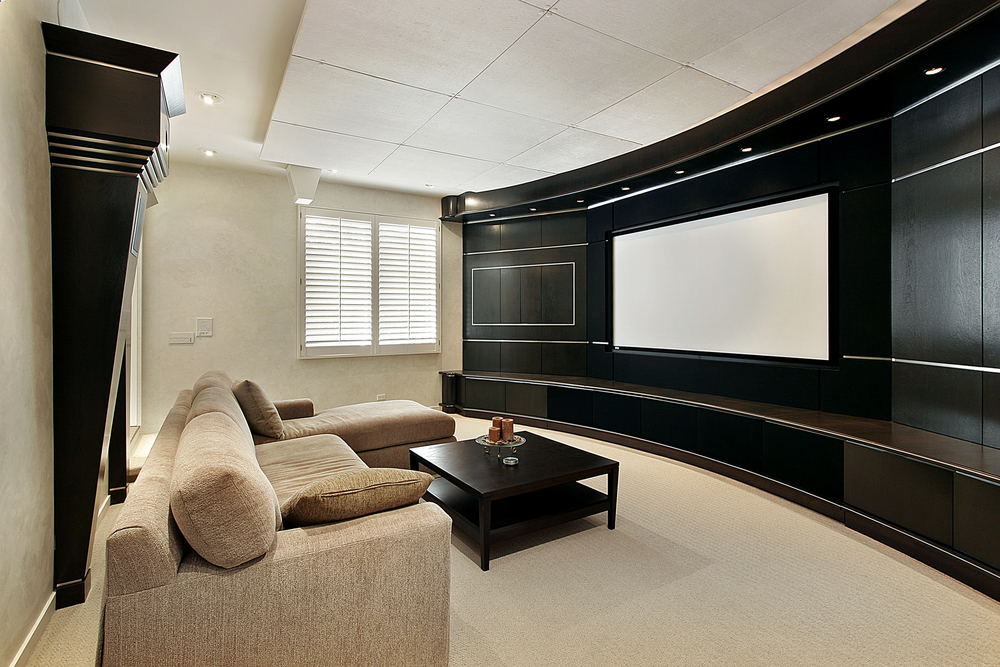 This room is more simple with only one large couch and a large television screen. All together it's a great design, however, and it's inexpensive compared to a lot of others.