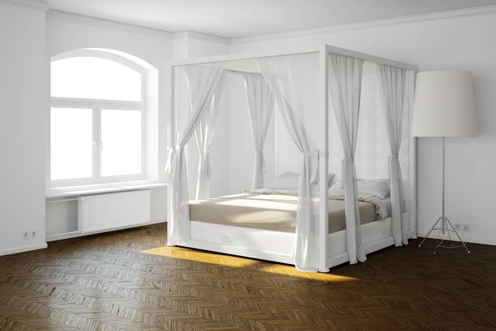 A contemporary canopy bed has a thinner frame