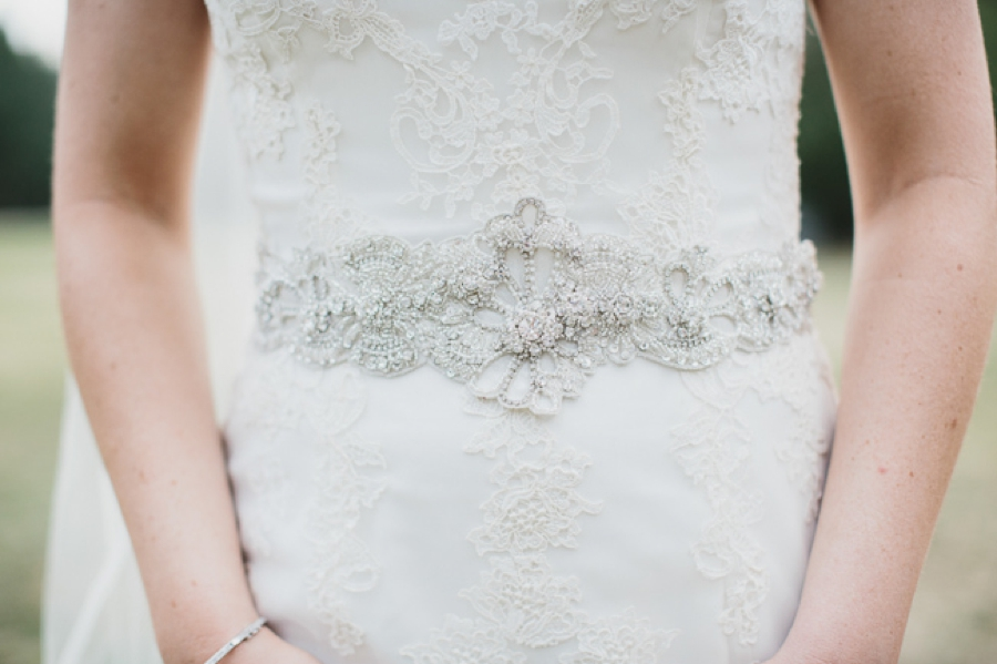 white lace overlay gown with crystal belt