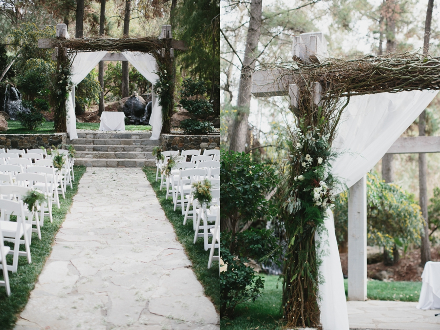 outdoor ceremony, wooden arch with evergreen accents