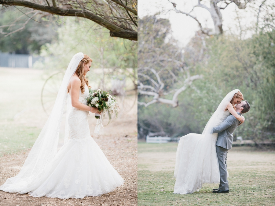 bride and groom romantics: bride in white strapless lace gown, groom in grey suit, white pinecone and evergreen bouquet