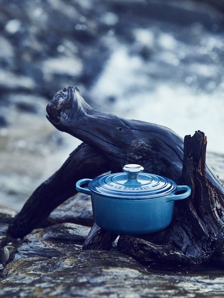 A Marine dutch oven tucked in to the arms of gnarled driftwood