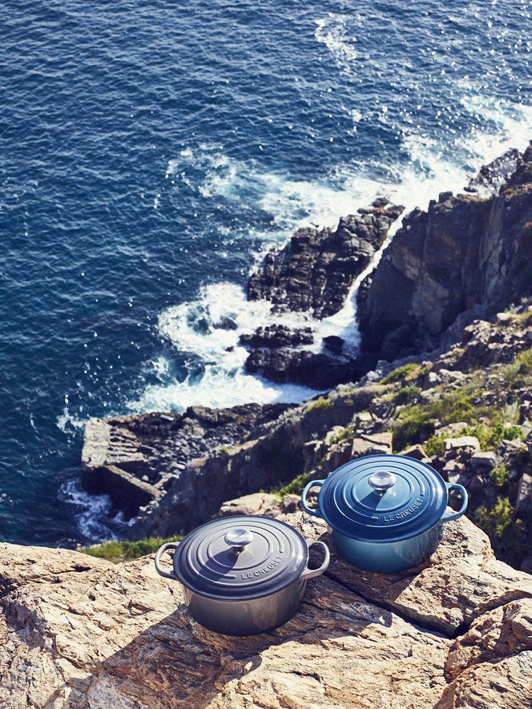 New Marine and Oyster dutch ovens overlooking a beach-side cliff