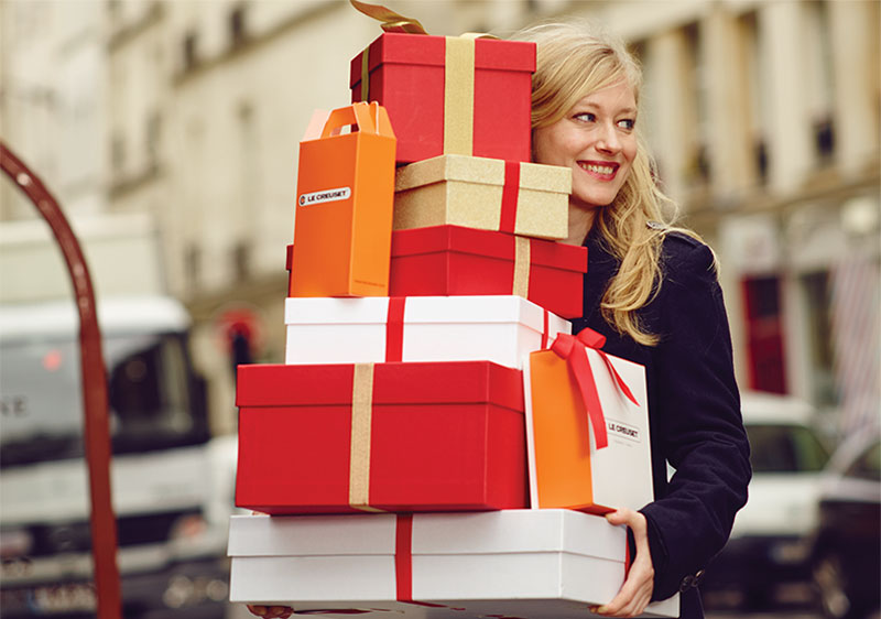 lady carrying a stack of gifts in the city