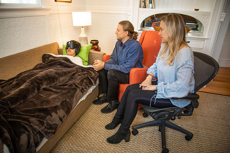 Veronika Gold and Eric Sienknecht attend to a therapy participant