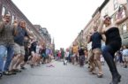 """Zachary P. Stephens/Reformer People gather together to participate in """"Bhangra"""" dancing on Main Street in Brattleboro during Gallery Walk, Friday evening."""