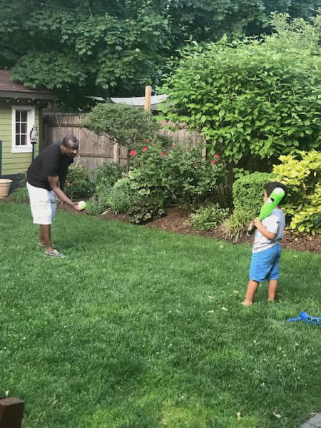 Uncle Edens teaching Ari how to swing a bat