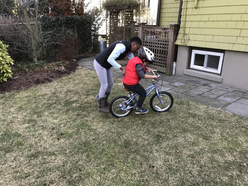 Teaching Ari to ride his bike