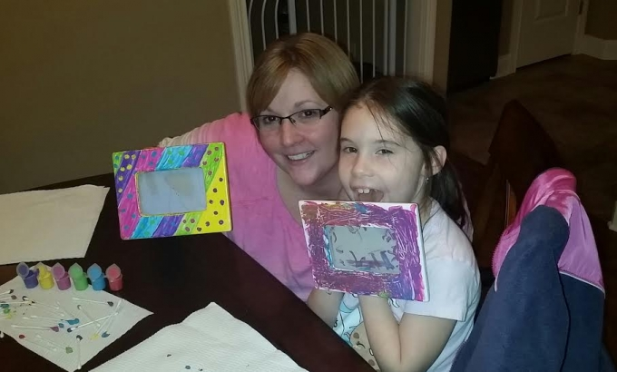 Amity and our niece showing off their freshly painted picture frames