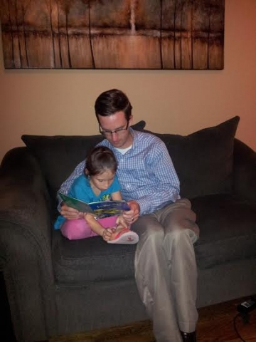Joseph helping our niece with her reading
