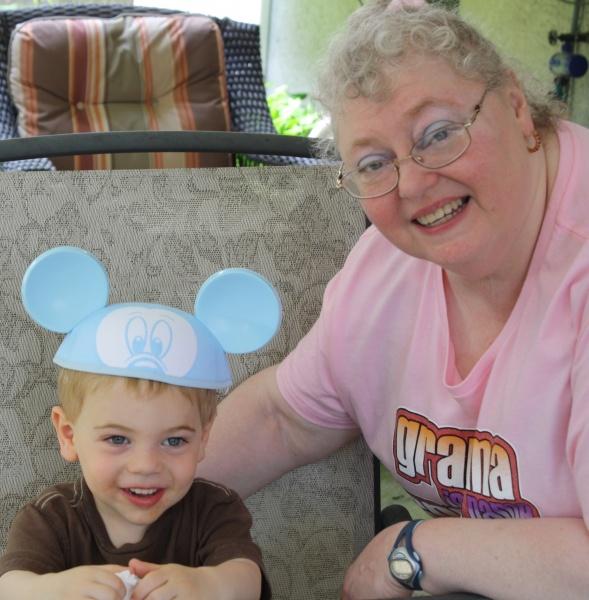 Trying on a Disney Souvenir with Grandma Elyse.