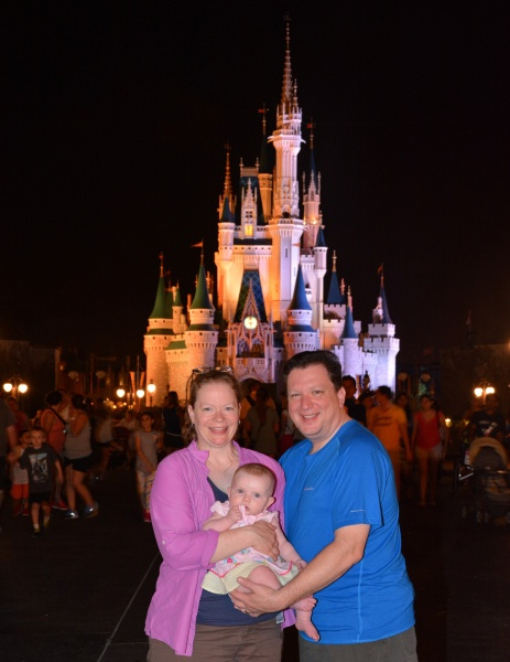 With our daughter at Disney - looking forward to going back with both children when we adopt again!