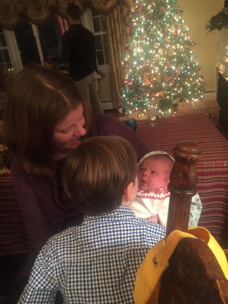 Admiring our newest cousin at a family tree decorating party