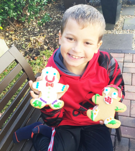 Our nephew enjoying gingerbread cookies on the patio!!