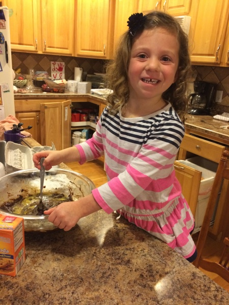 Emma helping mommy bake