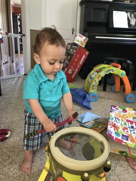 Our son Holden loves music--dancing, playing his drums and toy guitar, and singing.