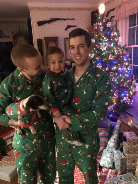 Being silly on Christmas with matching family pajamas