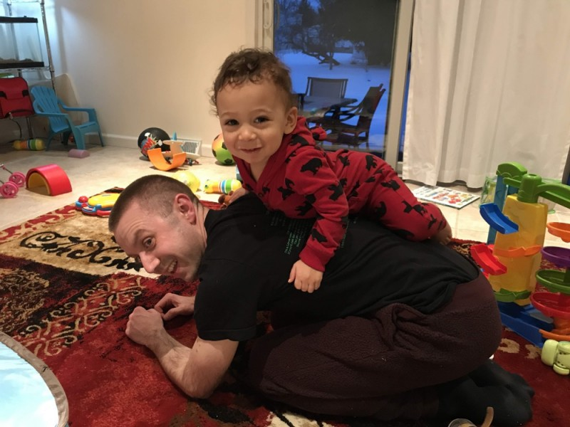 Our son loves to play and wrestle with his dads (wrestling here with Chris)