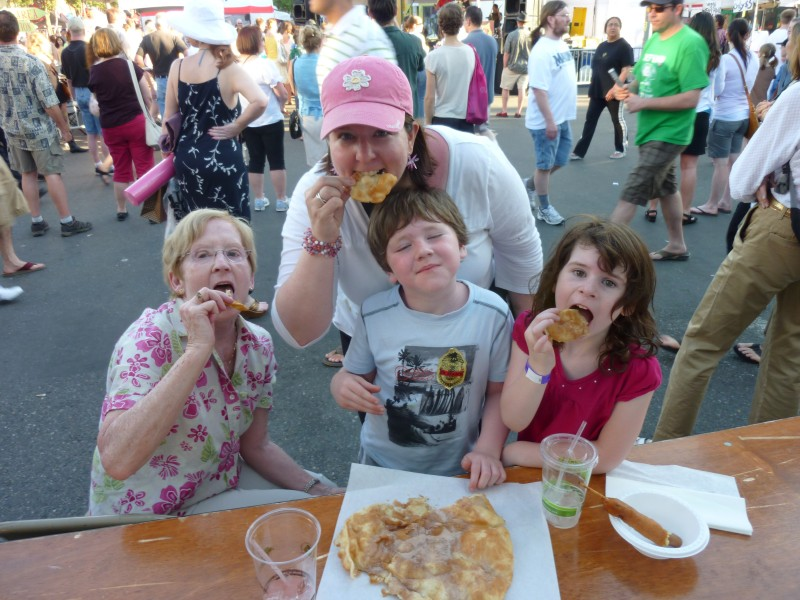 We love exploring neighborhood festivals, especially the yummy food!  Here is Michele with her Mom and niece and nephew.