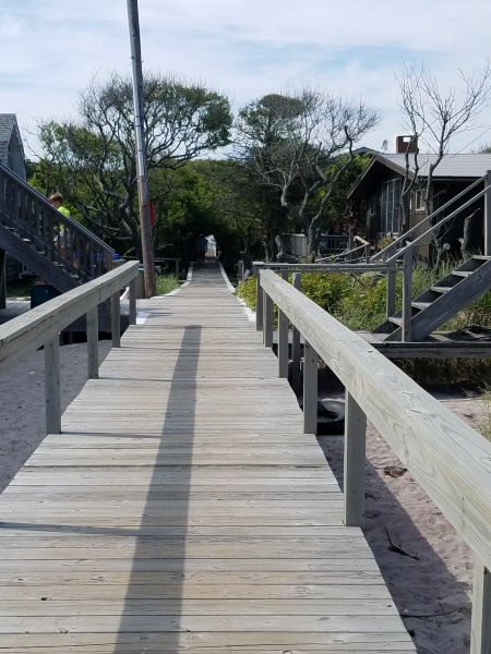 The walkway from the house to the ocean