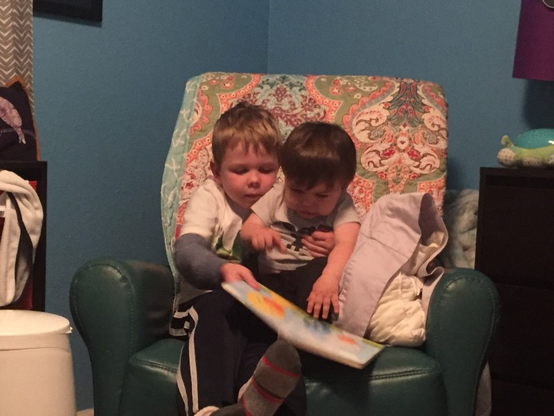Nick loves reading to his baby cousin