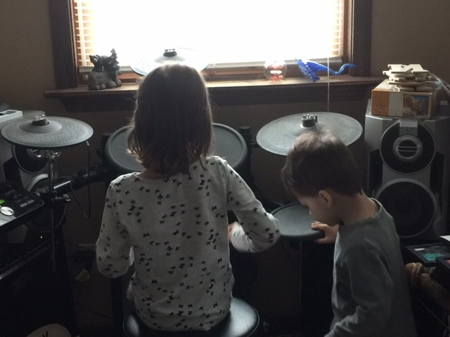 Our niece and nephew playing chris drums