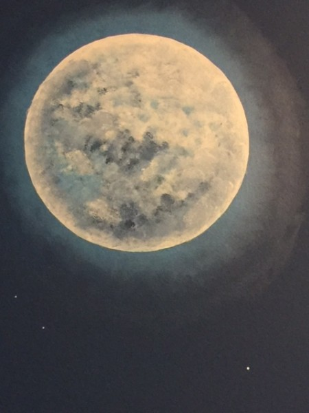 A moon Amanda painted on the wall
