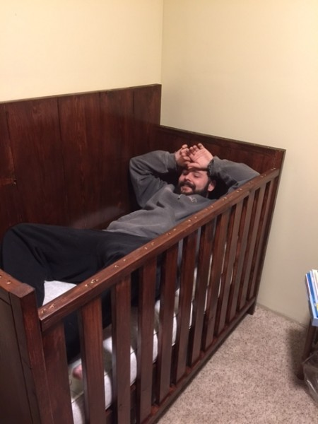 Chris trying out our nephews crib