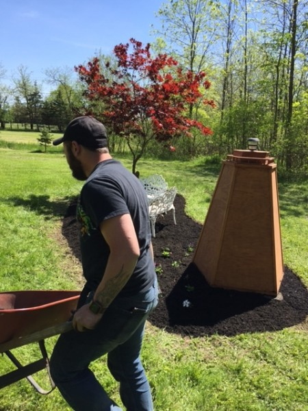 Chris making a garden for Amanda's parents