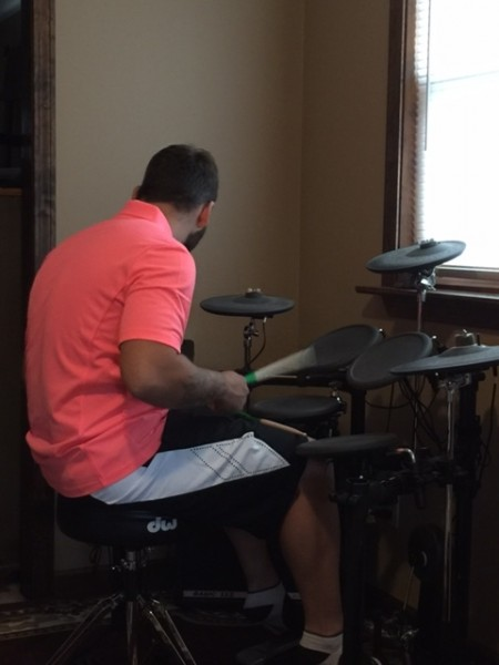 Chris playing his drums