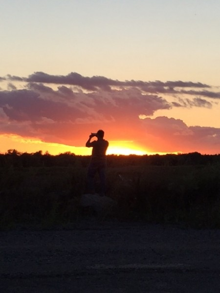 Chris taking a picture of the sunset, one of our favorite things to do