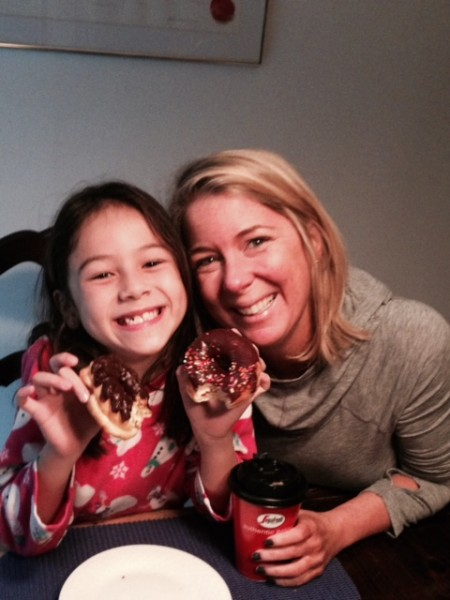 My niece that morning after a sleep over at my mom's...I bring the donuts.  Don't tell her mommy!  All I want is happiness for the kids...and if a donut on a Saturday morning when soccer is canceled, so be it!