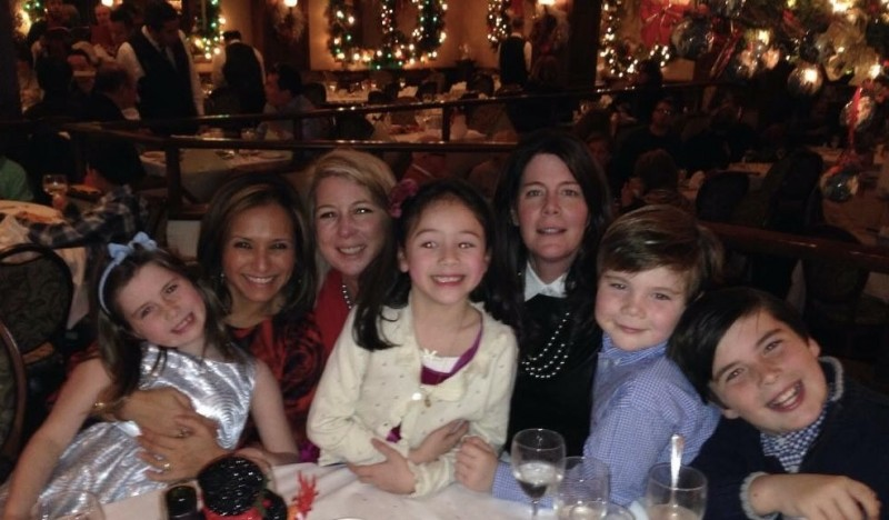 The whole gang at a holiday dinner. This restaurant an fabulous at Christmas and its on our tradition list. They have carolers and crazy decorations.  The kids LOVE it...so do the adults. We can't wait to share the magic with another child.