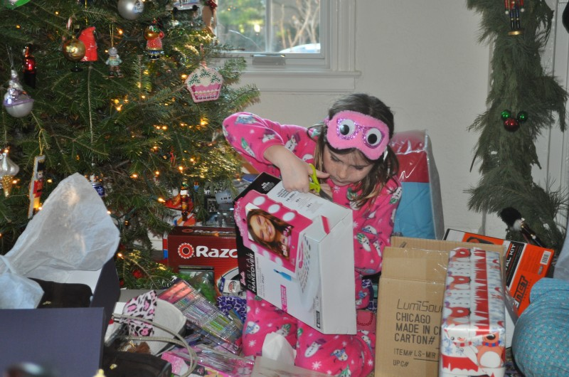 My niece enjoying her favorite day, every kid's, big or small, favorite day - Christmas!  Christmas morning is a BIG day for us.  We go to my sister's in pj's for brunch and all of the presents. It's insane and amazing!
