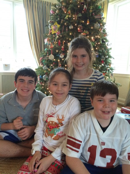 The four kids, exhausted on Christmas morning. This is at the brunch which why everyone looks a little wild eyed! This baby is in for mayhem...sometimes Santa even stops bye!