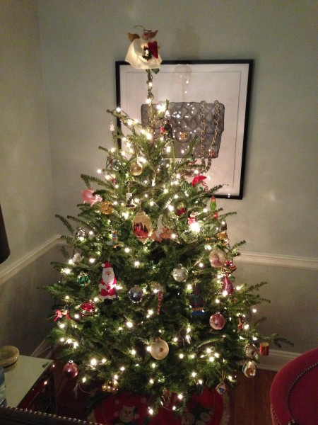 A little tree but just as magical. I wish we could leave the trees and lights up all year. They make me happy and I can't wait to share he magic of the holidays with a little person.