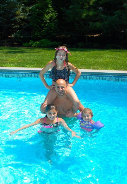 Ralph and our friends kids enjoying the pool