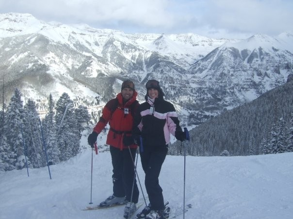 Honeymooning in Telluride, CO. We enjoy skiing, though don't do it as much as we'd like.