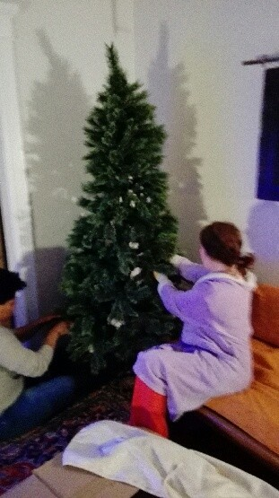Emily helping me set up the tree...