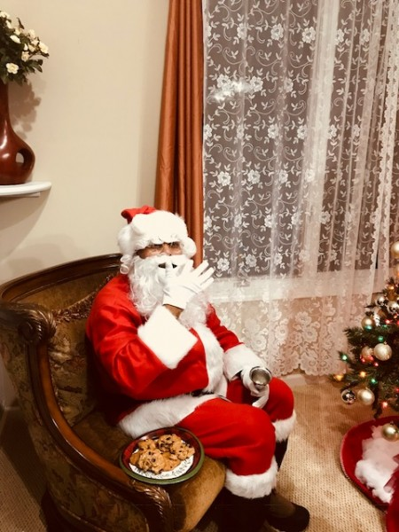 Santa on a cookie break after an hour dance with kids