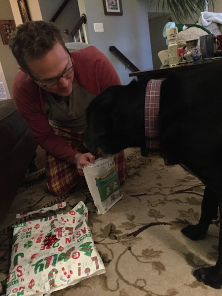 Boo unwrapping a gift
